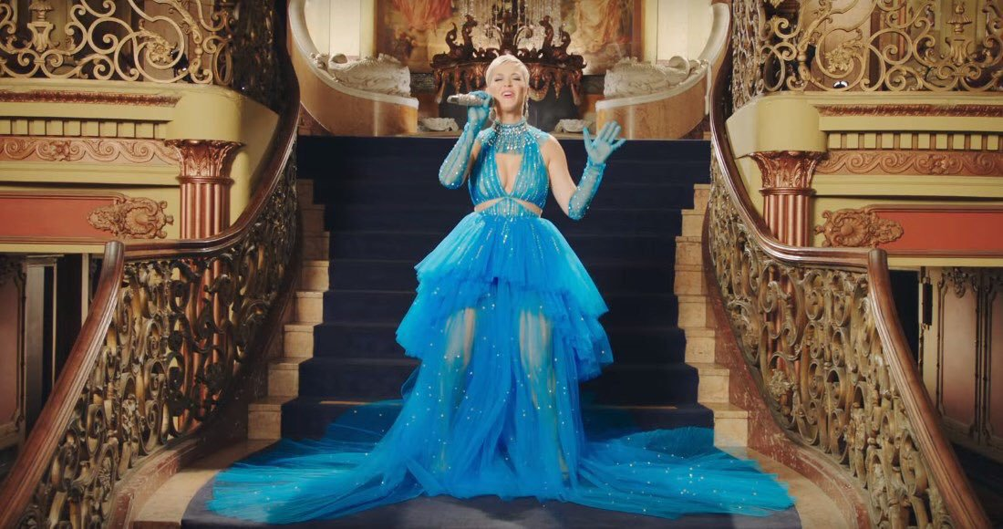 A screenshot from the music video for Immortal Flame shows Katy Perry wearing a dress by Cong Tri