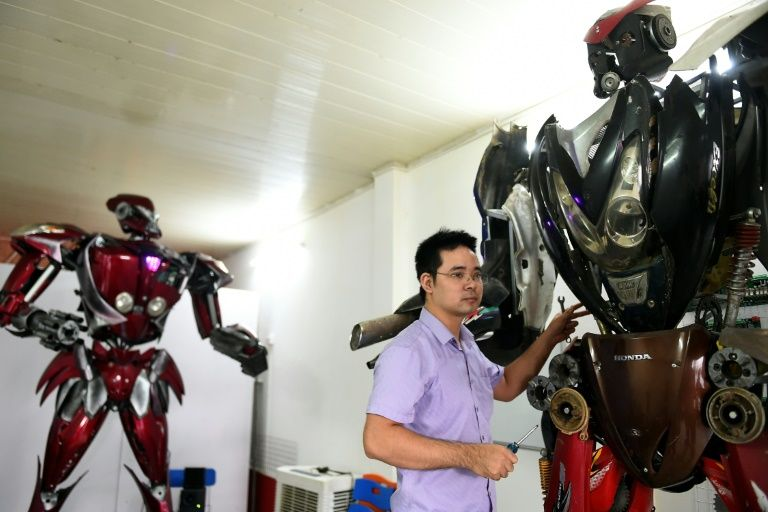 Robot One (L) is just the first of many, the engineers say, with dreams of creating a robot park in Hanoi one day. Photo: AFP