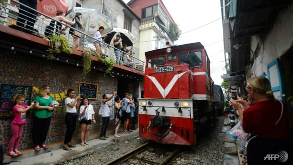 Hanoi begins clearing famed railway cafés after train pulls emergency brake to avoid tourists