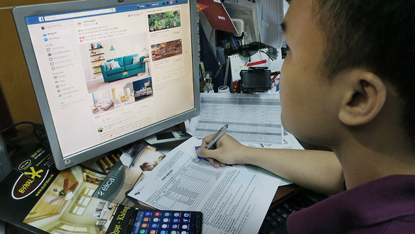 A man browses Facebook at his office in Ho Chi Minh City. Photo: T.T.D. / Tuoi Tre