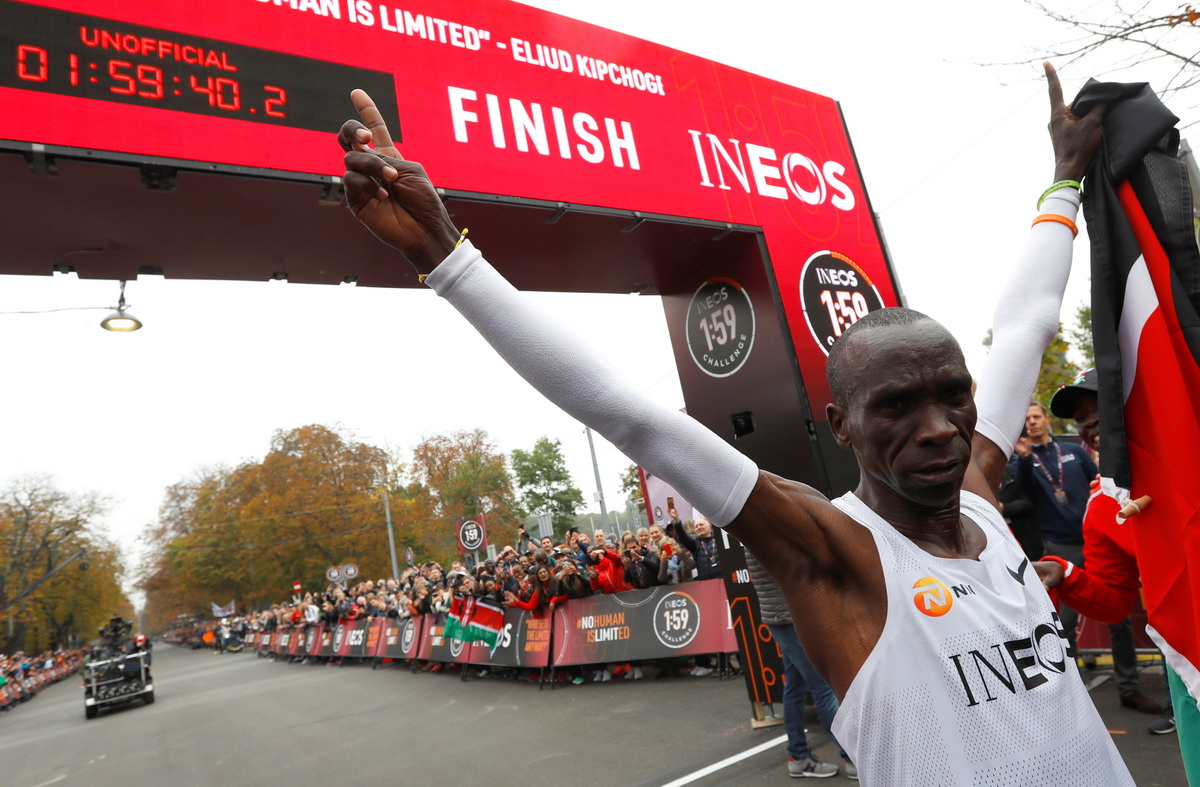 Kenya's Eliud Kipchoge, the marathon world record holder, celebrates after crossing the finish line during his attempt to run a marathon in under two hours in Vienna, Austria, October 12, 2019. Photo: Reuters