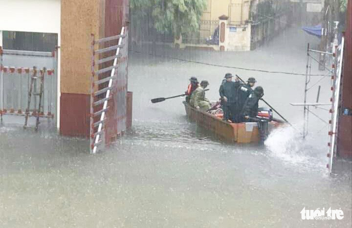 Authorities evacuate residents in Vinh City on a speedboat.