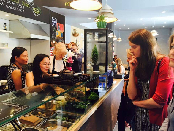 Customers stand at the sales counter as they choose pho at TAVS Banh mi restaurant in Riga, Latvia. Photo: Thanh My / Tuoi Tre
