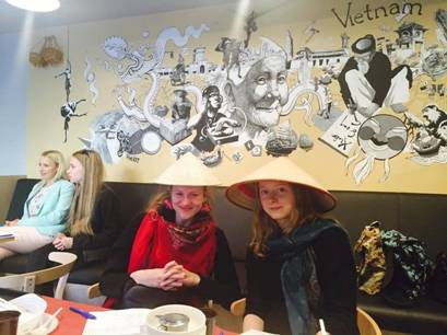Customers are seen wearing Vietnam's traditional 'non la' (conical hat) at TAVS Banh mi restaurant in Riga, Latvia. Photo: Thanh My / Tuoi Tre