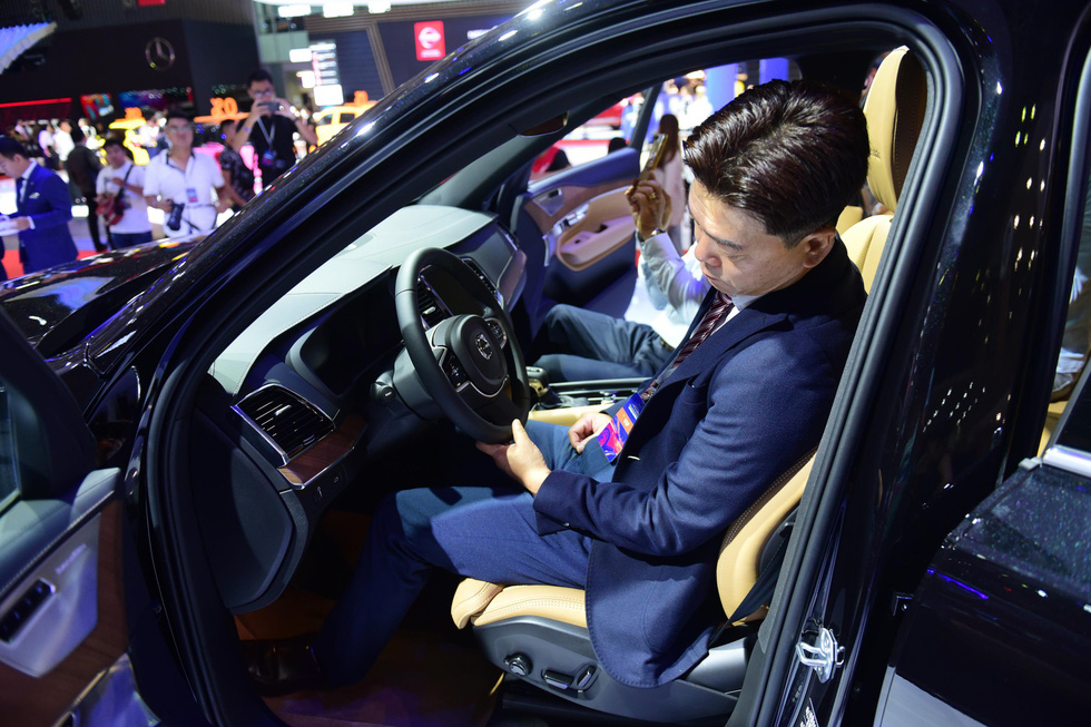 A man tests a car at the Vietnam Motor Show 2019. Photo: Quang Dinh / Tuoi Tre