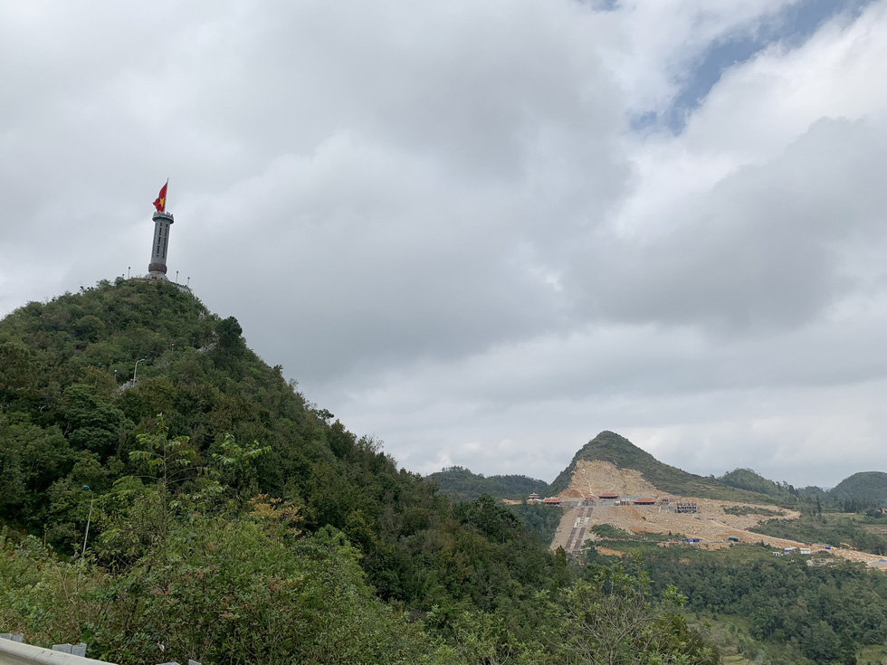 Lung Cu National Flag Tower is seen in Lung Cu Commune, Dong Van District, Ha Giang, Vietnam, with the construction site of a spiritual project spotted afar. Photo: Huu Thang / Tuoi Tre