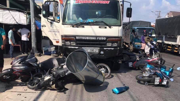 11 injured as truck crashes into motorcyclists at red light in Vietnam