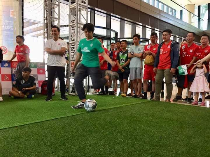 """A contestant takes a penalty kick at the """"Bundesliga Penalty Shootout"""" held at the Deutsches Haus Ho Chi Minh City in District 1, October 26, 2019, in this photo uploaded on the Facebook page of the event"""