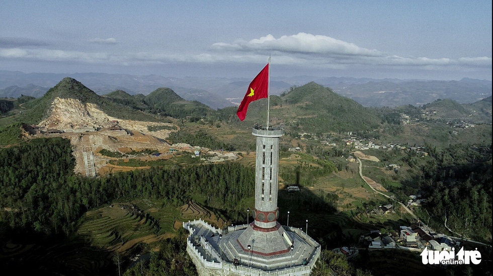 Lung Cu National Flag Tower is seen in Lung Cu Commune, Dong Van District, Ha Giang Province, Vietnam, with the construction site of a religious tourism project on a flattened mountain spotted afar. Photo: L.D.Q. / Tuoi Tre