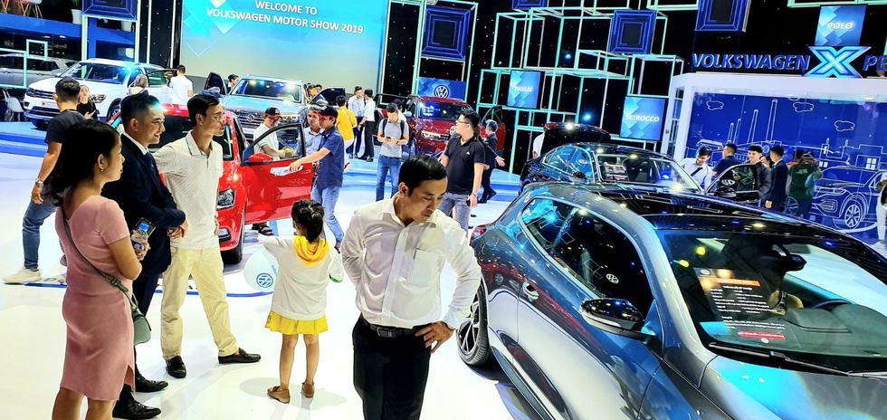 Volkswagen cars with illicit 'nine-dash line' maps displayed at Vietnam Motor Show