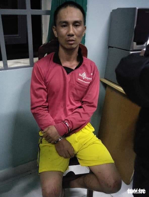 Tran Van Tuan is arrested by police on October 30, 2019. Photo: Mai Vinh / Tuoi Tre