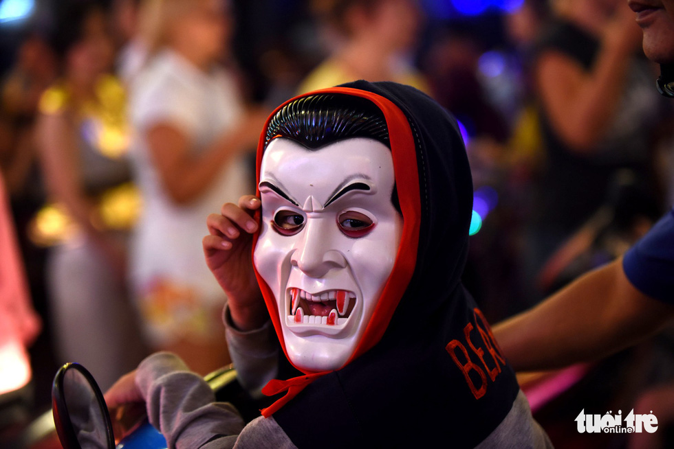 A boy dons a vampire mask on Bui Vien Street in District 1, Ho Chi Minh City, October 31, 2019. Photo: Duyen Phan / Tuoi Tre