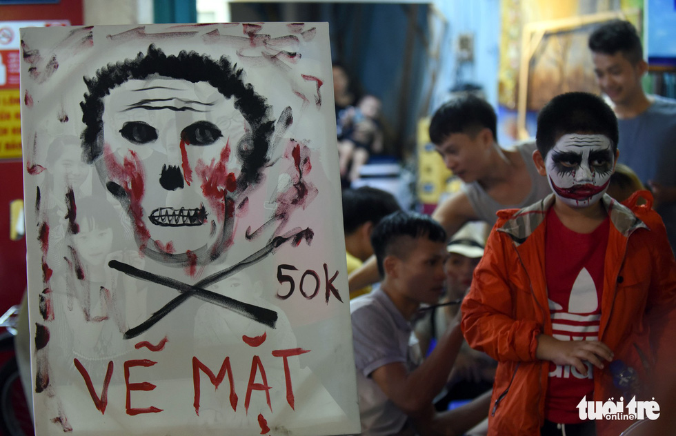 A board shows off prices for Halloween themed face painting on Bui Vien Street in District 1, Ho Chi Minh City, October 31, 2019. Photo: Duyen Phan / Tuoi Tre