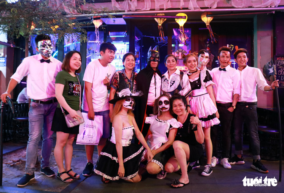 A group of waiters pose in their Halloween-themed make-up in front of a restaurant on Bui Vien Street in District 1, Ho Chi Minh City, October 31, 2019. Photo: Ngoc Phuong / Tuoi Tre