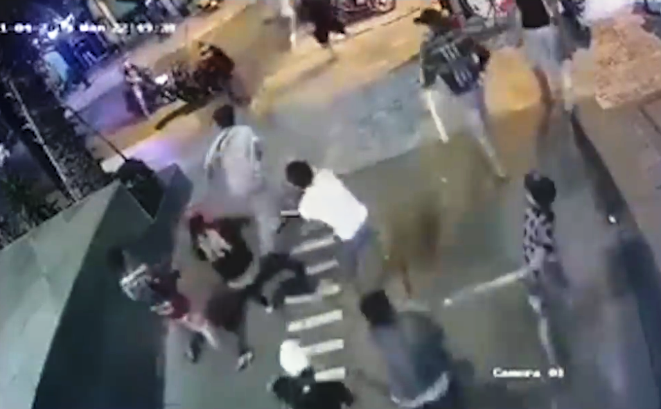 Mai Van Quan is attacked by a group of men in Thu Duc District, Ho Chi Minh City, November 4, 2019 in this screenshot taken from CCTV footage.