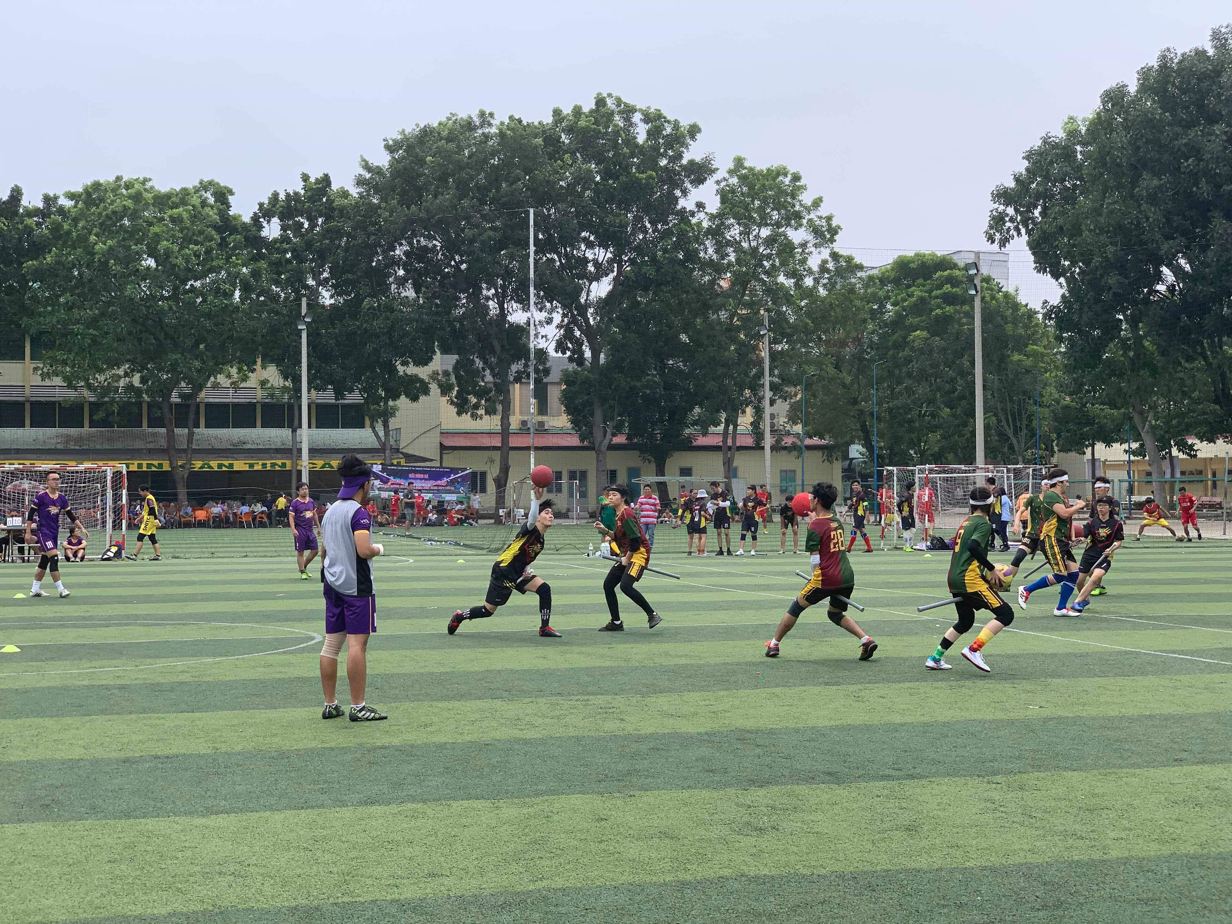 Two 'beaters' try to throw 'bludgers' at each other during a match in the maiden Vietnam Quidditch Cup organized by the Vietnam Quidditch Association  in Tan Binh District, Ho Chi Minh City, November 10, 2019 in this provided photo