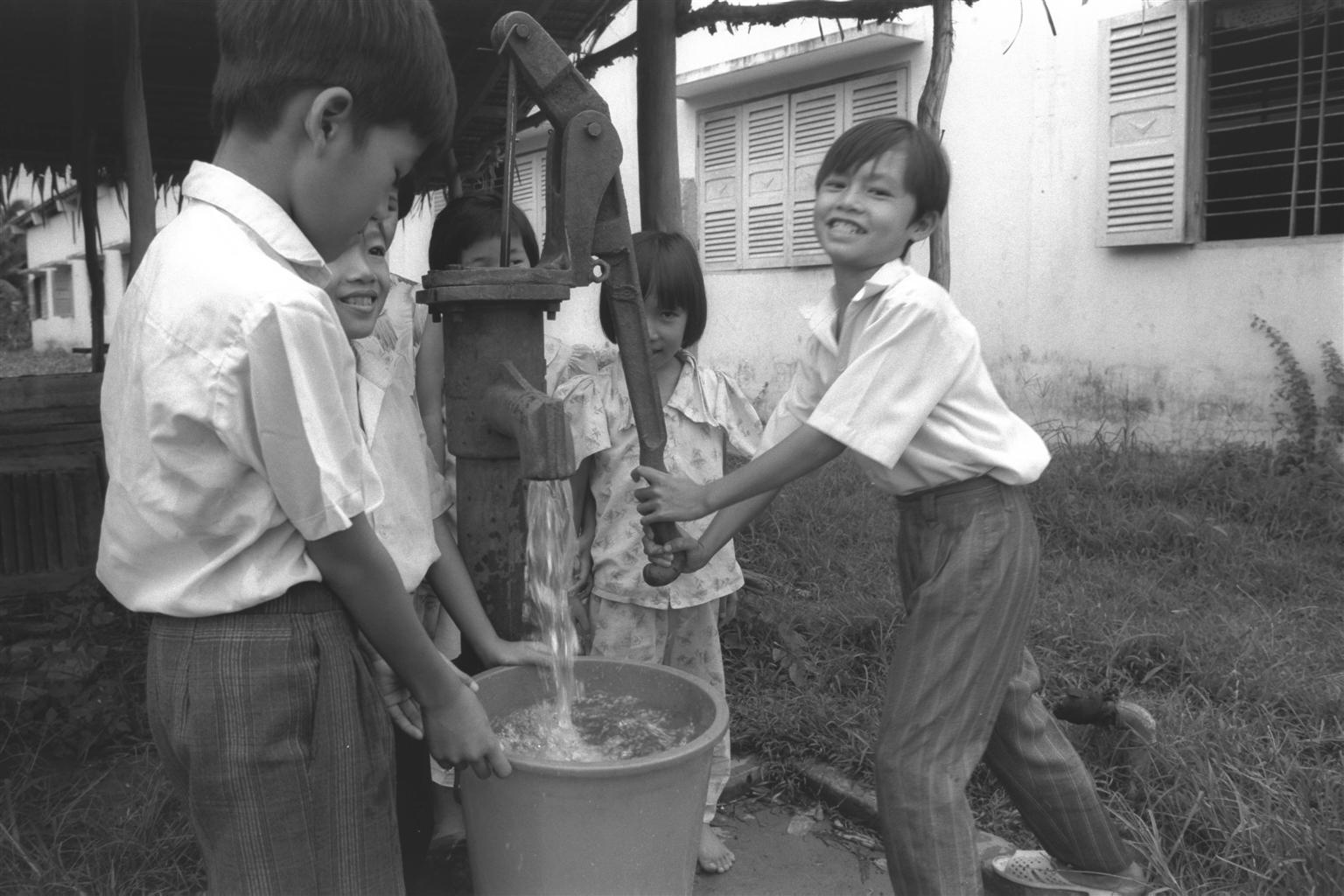 Children pump water at a school in Long An Province, southern Vietnam, in this file photo taken in 1993. Photo: UNICEF