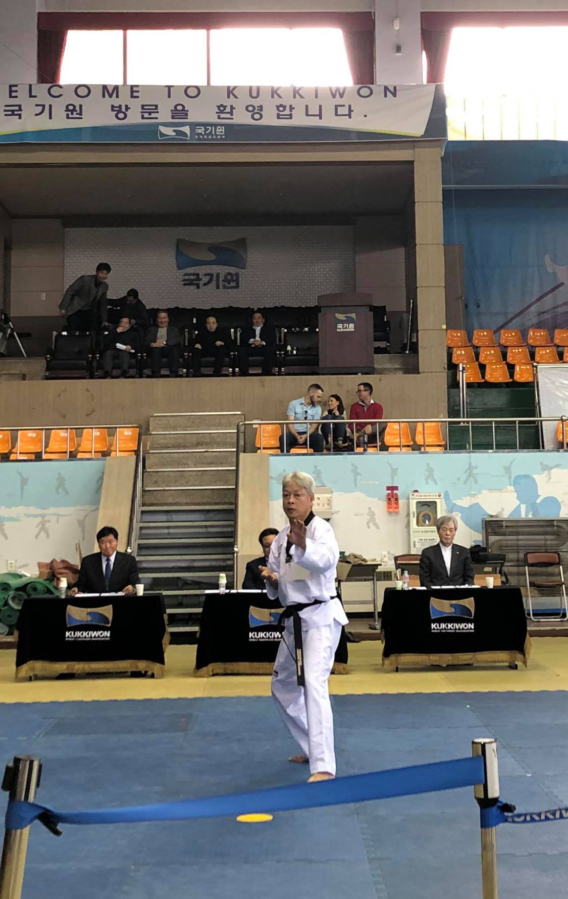 Vietnamese taekwondo master Truong Ngoc De performs a practical test before a panel of judges during a ninth-degree black belt promotion test in Seoul, South Korea on November 11, 2019. Photo: Thanh Huy / Tuoi Tre