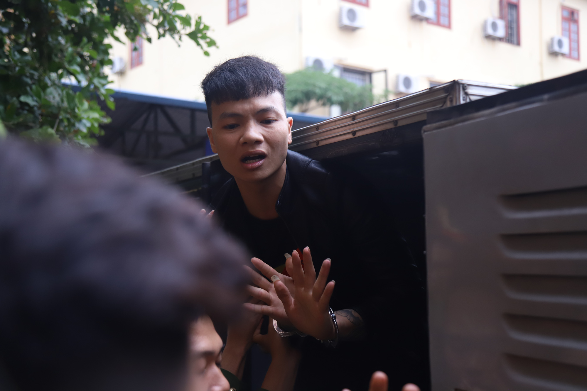 Ngo Ba Kha waves goodbye to his family and friends following a trial in the northern province of Bac Ninh on November 13, 2019. Photo: Danh Trong / Tuoi Tre