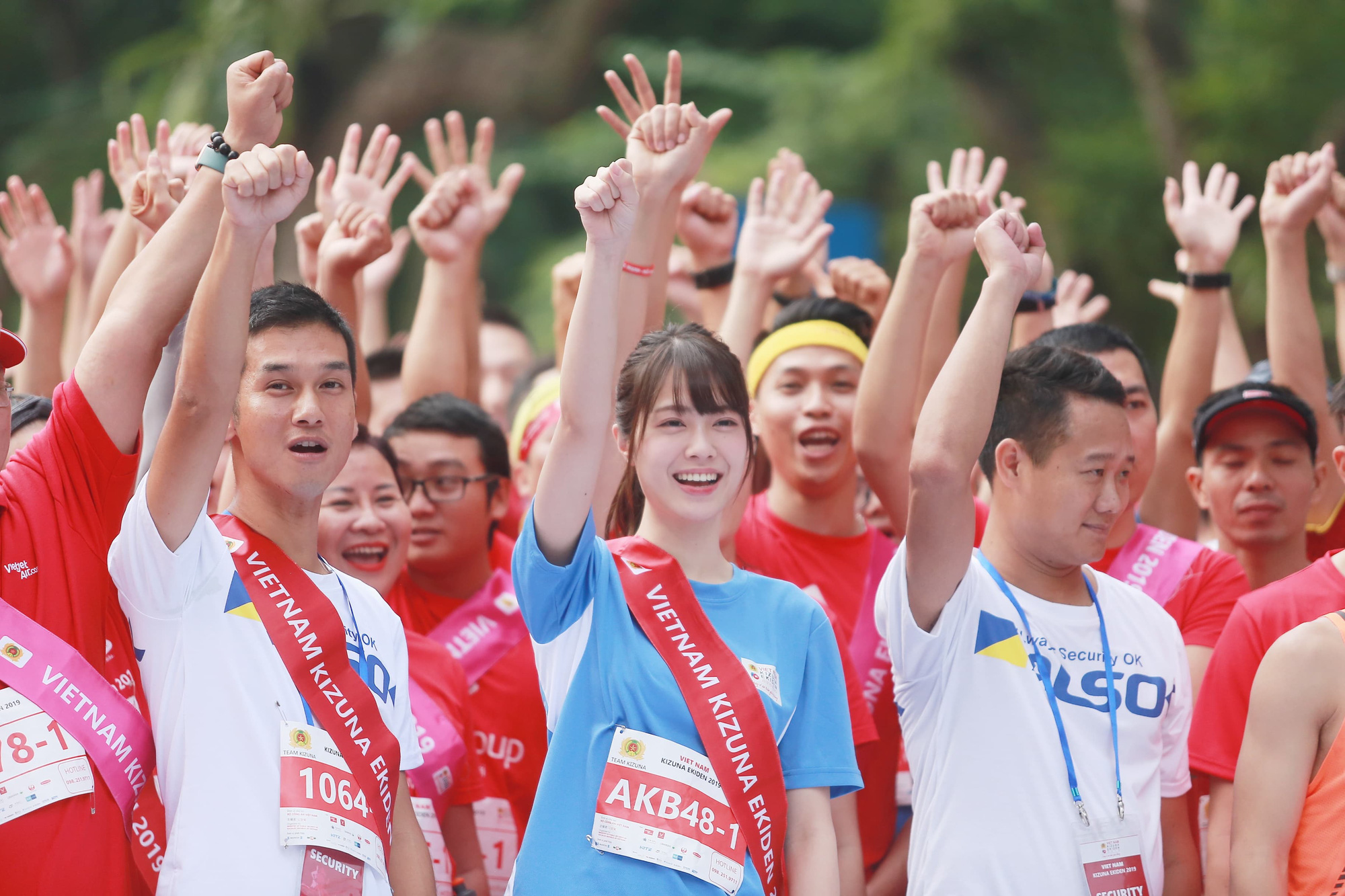 A member of Japanese girl idol group AKB48 is pictured at the starting point.