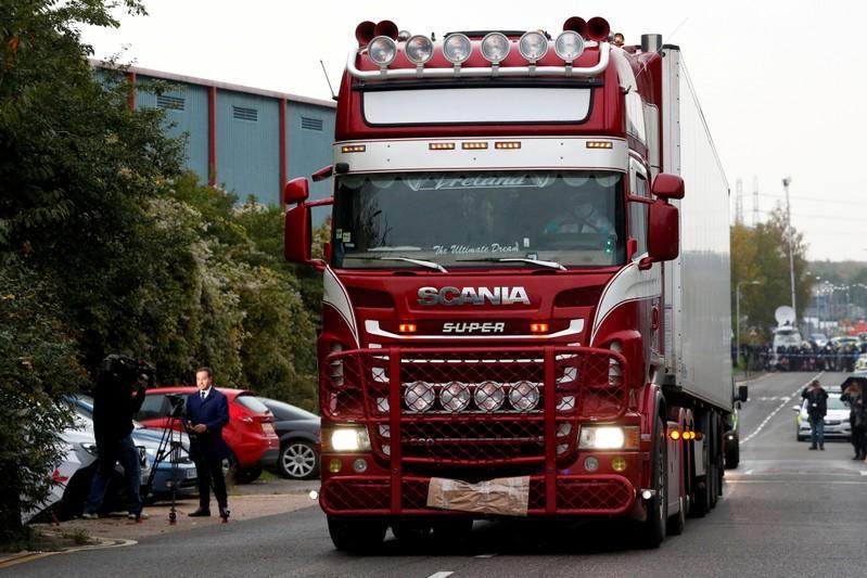 UK police arrest man in enquiry over Vietnamese truck deaths