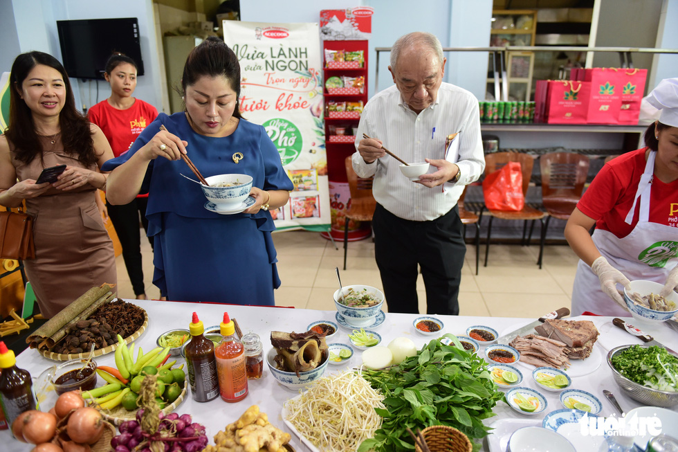 The judges try pho in the qualification round of a cooking contest searching for the best pho chefs in Vietnam held in Ho Chi Minh City, November 23, 2019. Photo: Quang Dinh / Tuoi Tre