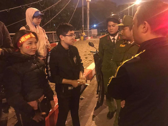 Bin Nguyen talks with police officers after an incident on November 19, 2019 in this provided photo