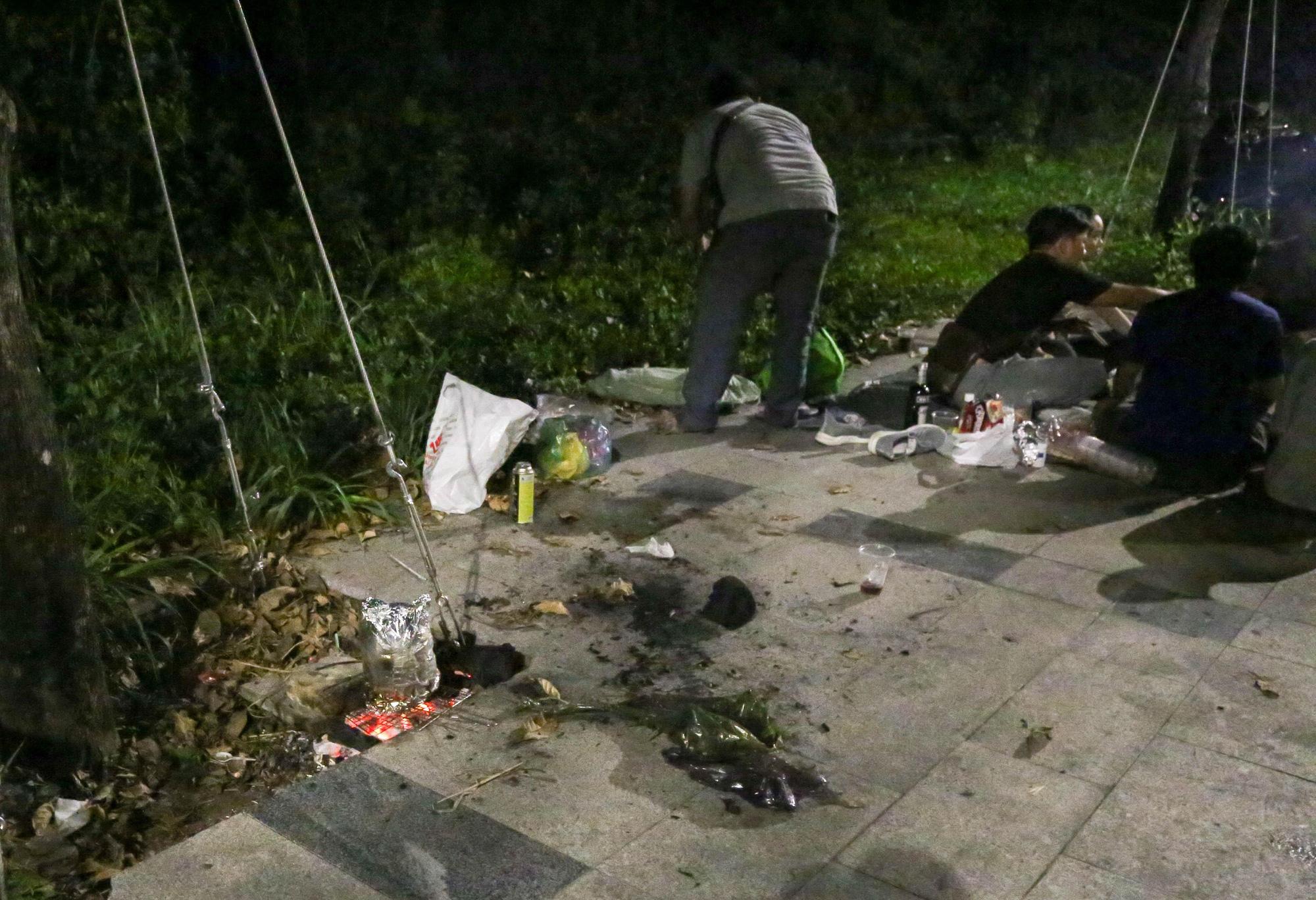 <em>Trash and charcoal create a messy scene on the promenade.</em> <em>Photo:</em> Thao Le / Tuoi Tre