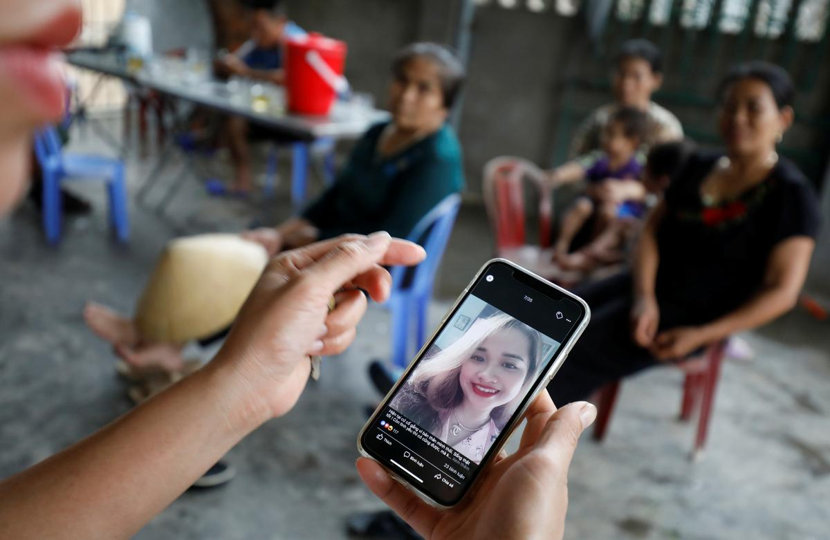 A relative looks at an image of Anna Bui Thi Nhung, a victim who was found dead in the back of British truck last month, at her home in Nghe An Province, Vietnam October 26, 2019. Photo: Reuters