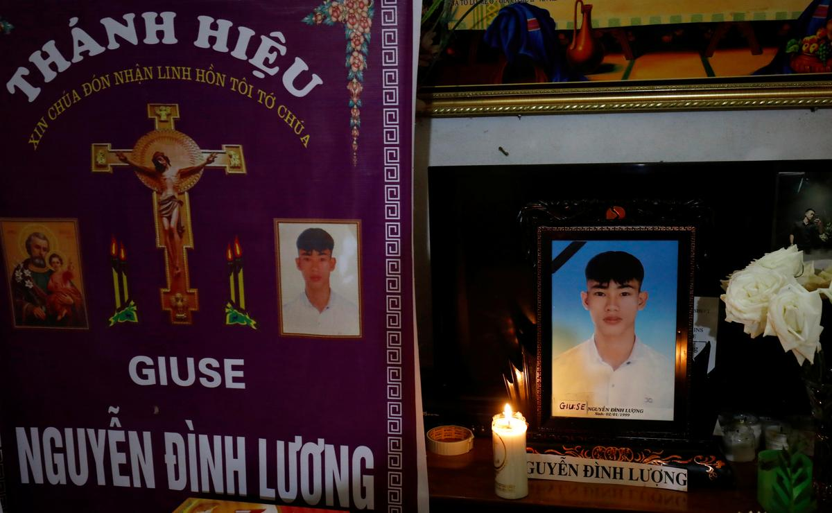 Images of Nguyen Dinh Luong, a victim who was found dead in the back of British truck, are seen at his home after his funeral in Ha Tinh Province, Vietnam November 29, 2019. Photo: Reuters