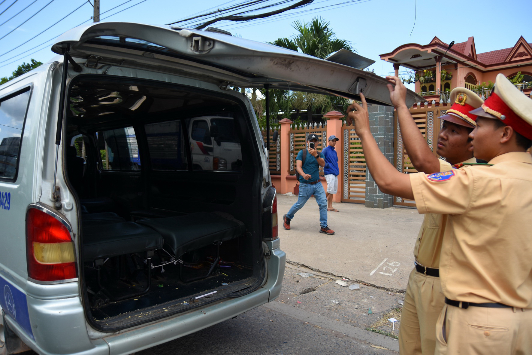 Students fall out of school vans in separate cases in southern Vietnamese province