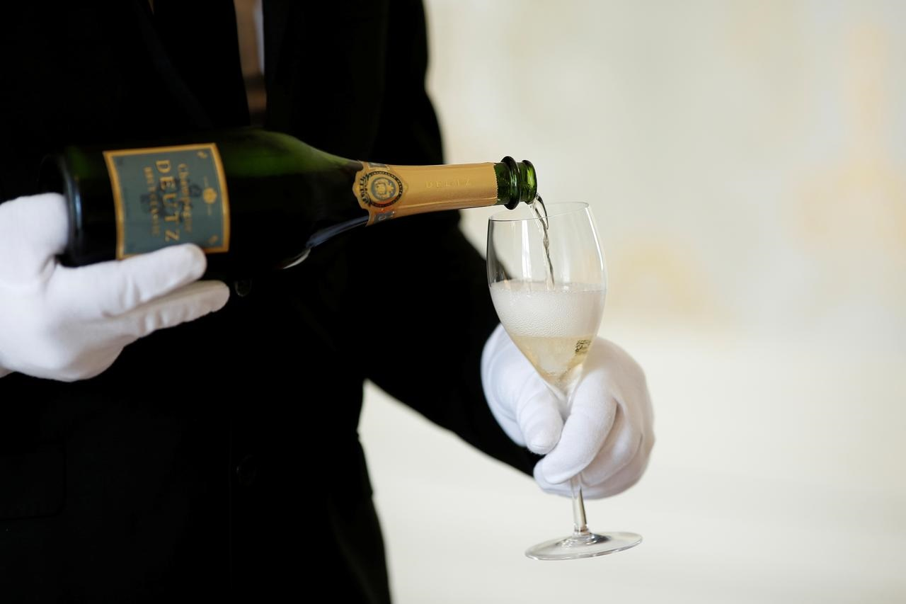 U.S. vows 100% tariffs on French Champagne, cheese, handbags over digital tax