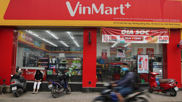 Why did Vietnam's largest conglomerate sell off retail arm?