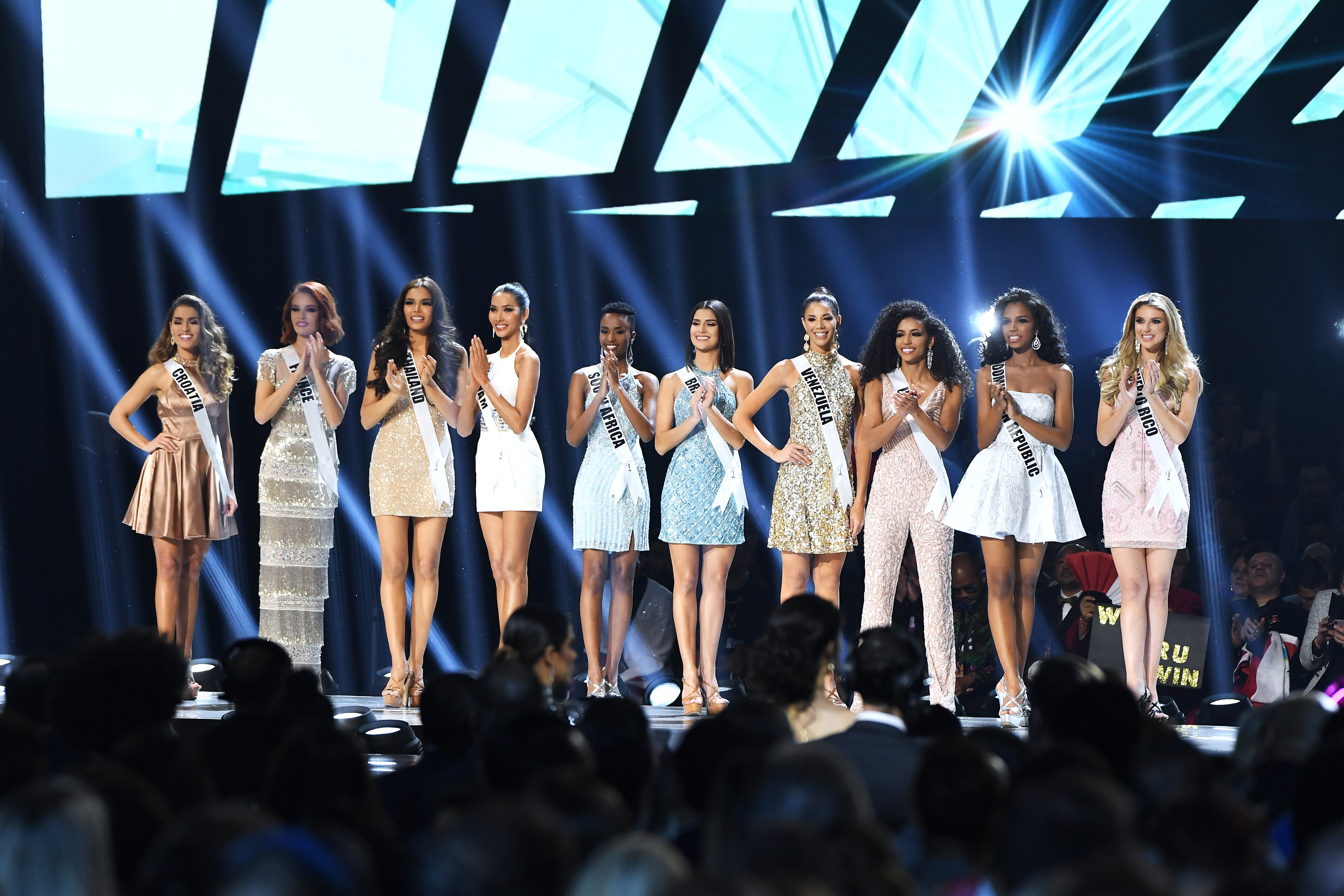 (L-R) Miss Croatia Mia Rkman, Miss France Maeva Coucke, Miss Thailand Paweensuda Drouin, Miss Vietnam Hoang Thuy, Miss South Africa Zozibini Tunzi, Miss Brazil Julia Horta, Miss Venezuela Thalia Olvino, Miss USA Cheslie Kryst, Miss Dominican Republic Clauvid Daly and Miss Puerto Rico Madison Anderson appear onstage at the 2019 Miss Universe Pageant at Tyler Perry Studios on December 08, 2019 in Atlanta, Georgia. Photo: AFP