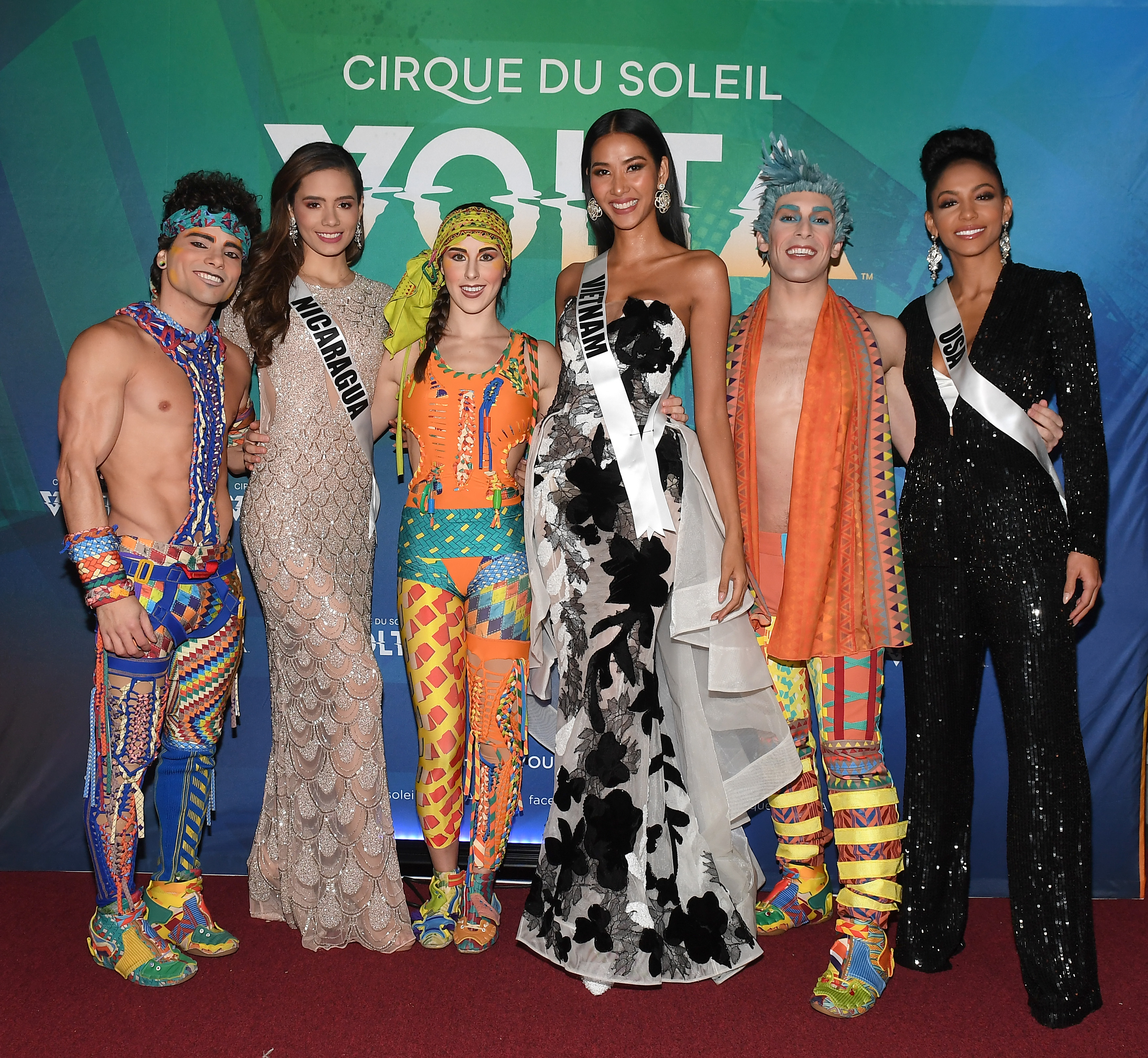 Miss Nicaragua Inés López, Miss Vietnam Hoang Thuy, and Miss USA Cheslie Kryst pose with cast members of Volta during Volta By Cirque Du Soleil at Atlantic Station on December 04, 2019 in Atlanta, Georgia. Photo: AFP