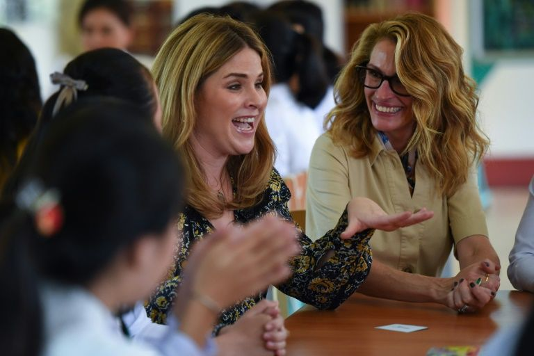 Obama was joined in Vietnam by the daughter of former US president George W. Bush, Jenna Bush Hager (left), and actress Julia Roberts (right). AFP Photo/Nhac NGUYEN