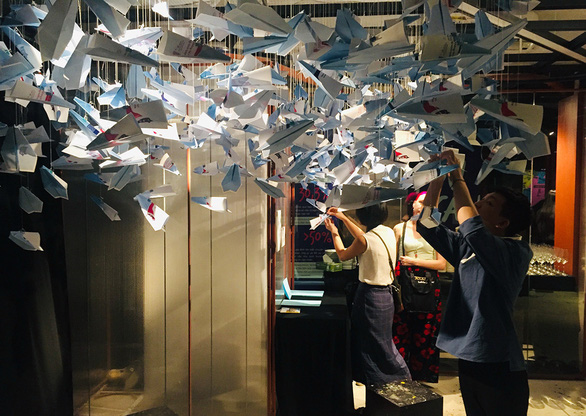 The installation 'Paper planes' on display at the 'You can talk to me' exhibition in Ho Chi Minh City on December 6-14, 2019. Photo: Mai Thuy / Tuoi Tre