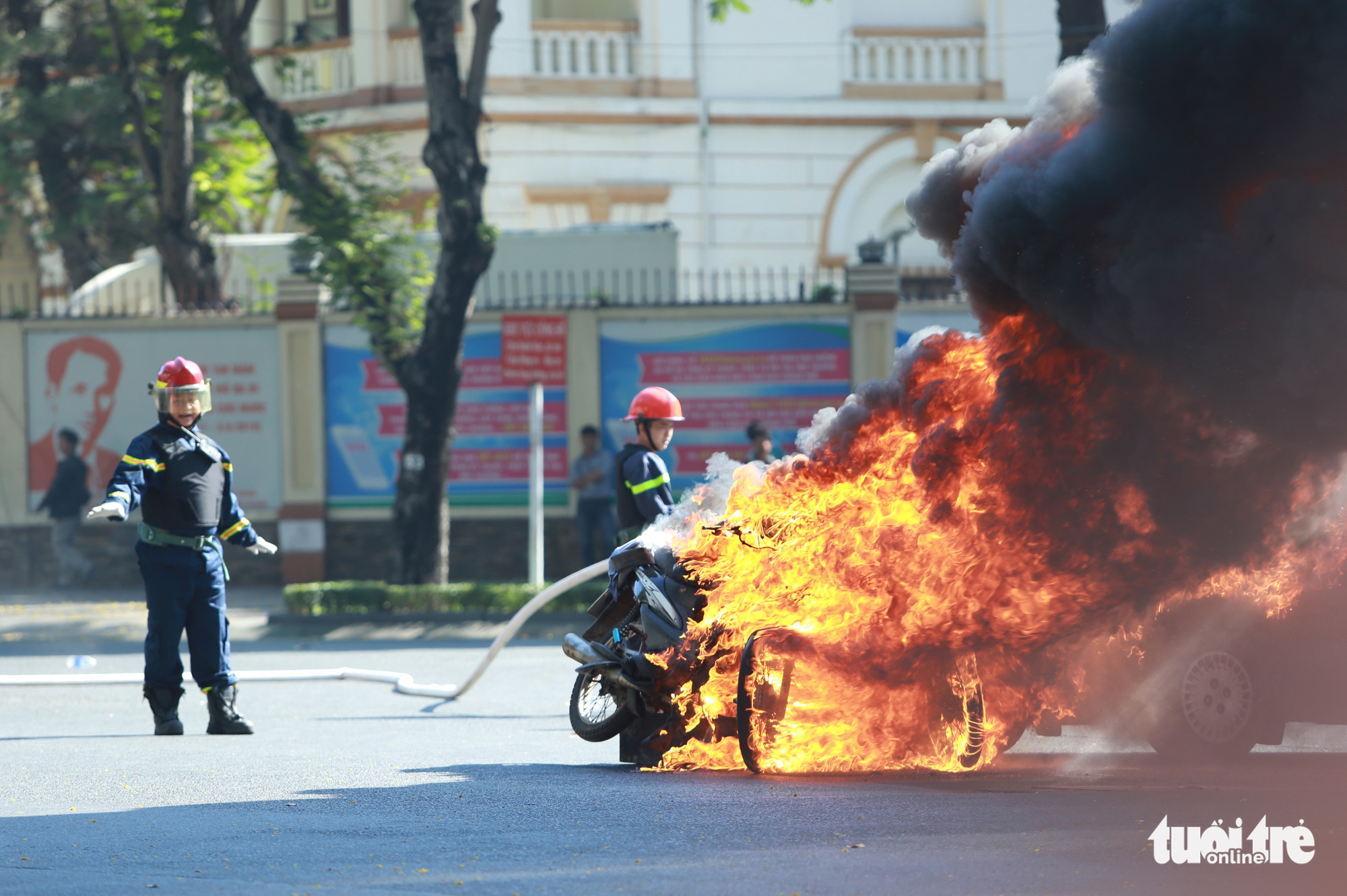 Firefighters put out a burning motorcycle.