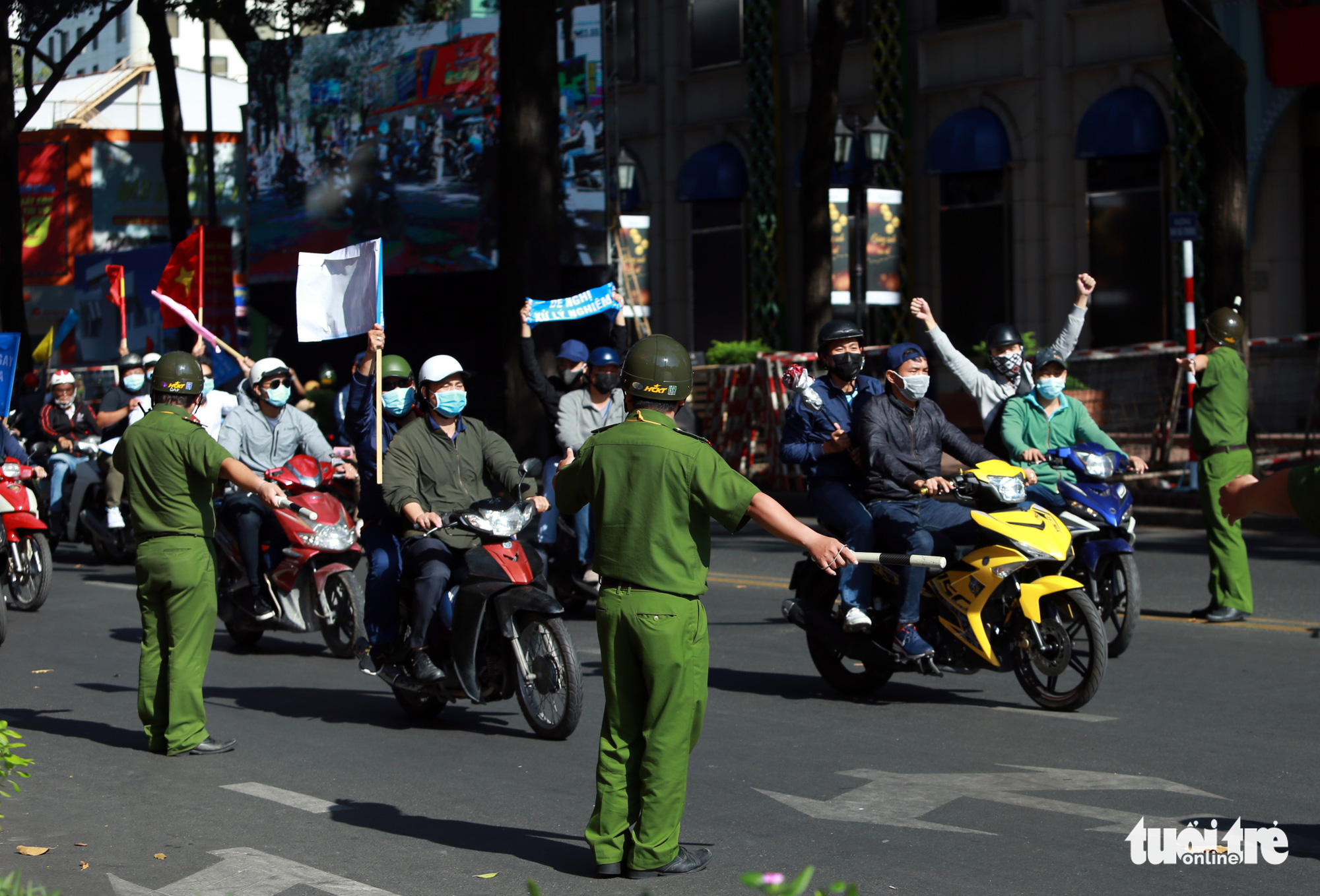 A group of people ride their motorcycles and stir up disorder on the streets.