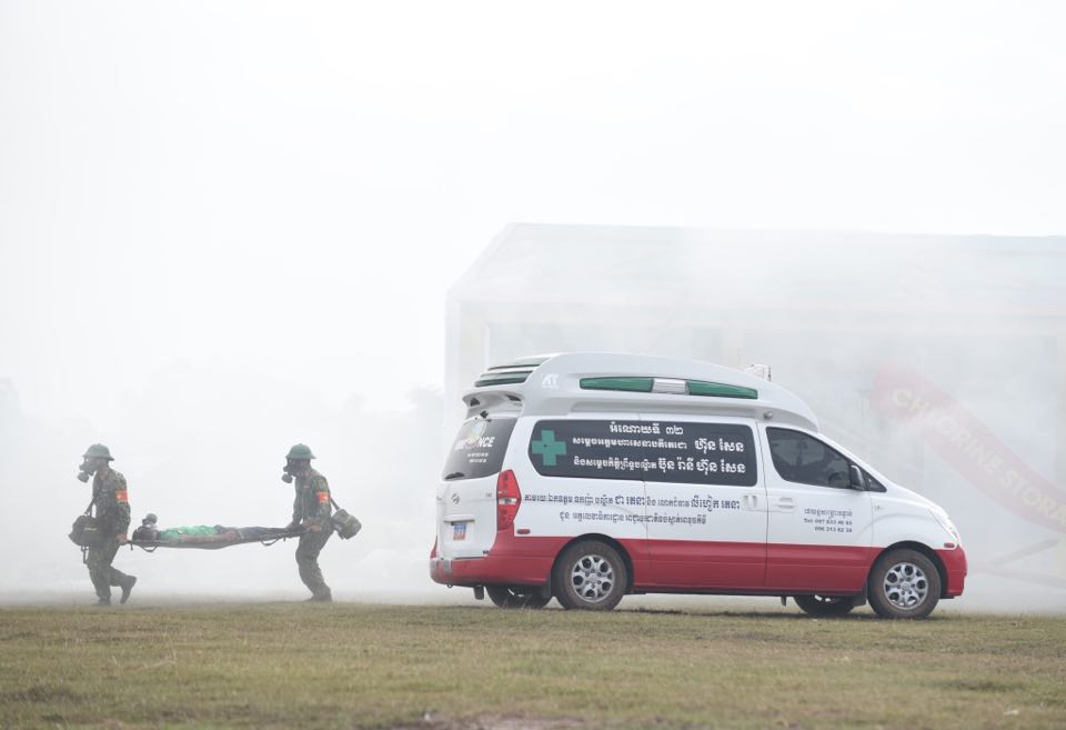 A victim is evacuated from the contaminated area of a mock chemical leak during a maiden disaster reponse exercise along the Vietnam-Cambodia border, December 18, 2019. Photo: Duyen Phan / Tuoi Tre