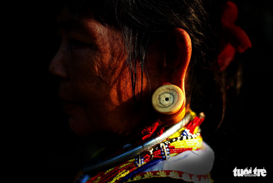 An earring made from ivory is featured in a photo on display at an outdoor exhibition in Da Lat in the Central Highlands of Lam Dong. Photo: M. Vinh / Tuoi Tre