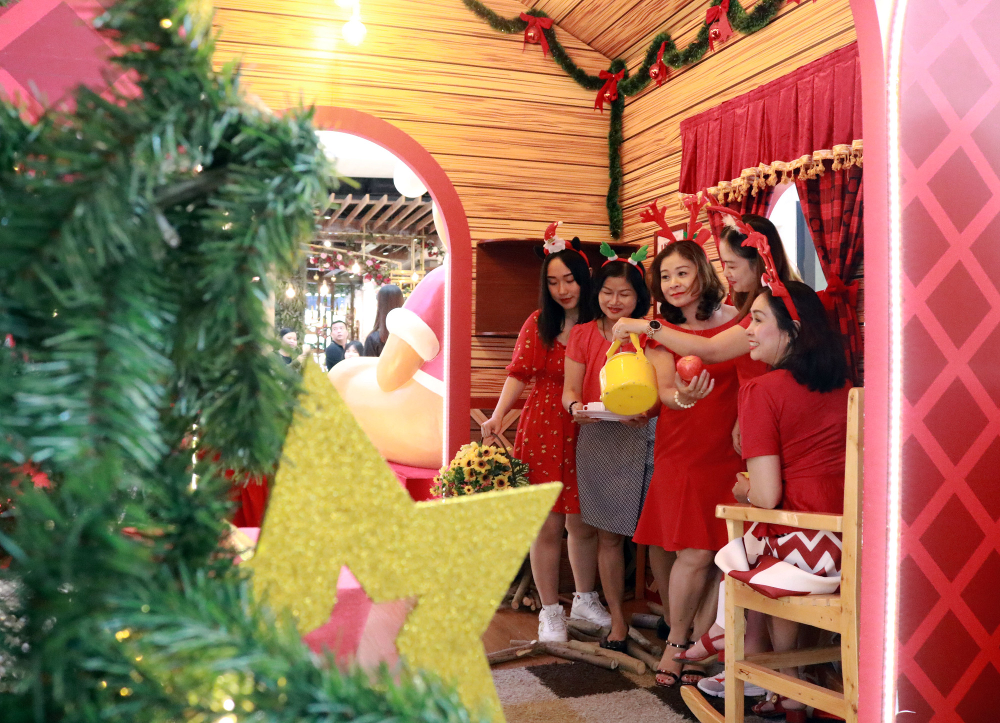 A group of women pose for a photo in their holiday outfits. Photo: Nhat Thinh / Tuoi Tre