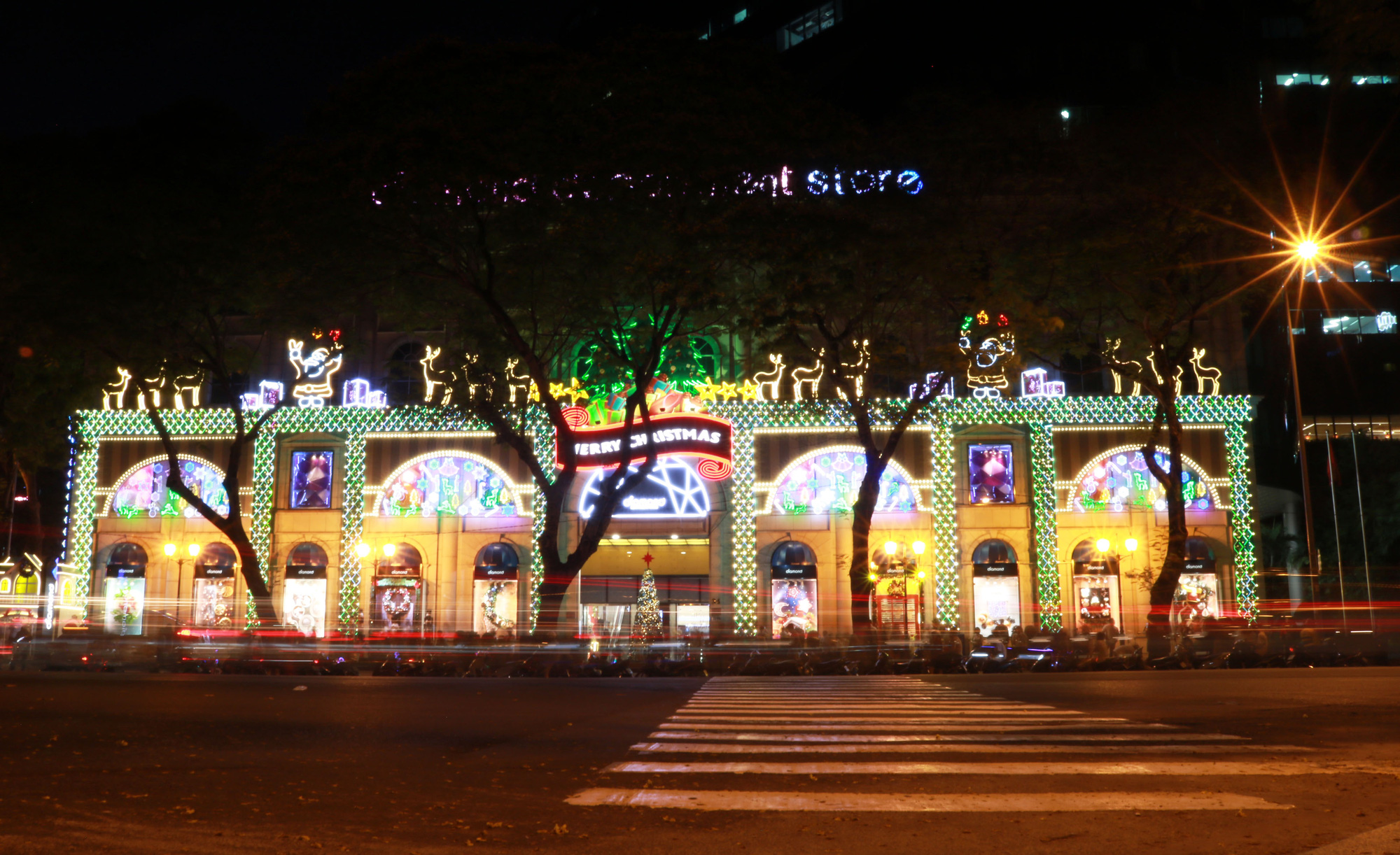Diamond Plaza in downtown Ho Chi Minh City lights up in the evening. Photo: Nhat Thinh / Tuoi Tre