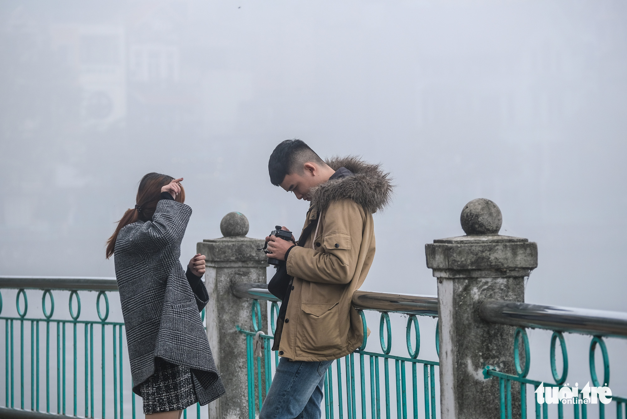 Young people take photos of the foggy weather in Hanoi on December 24, 2019.