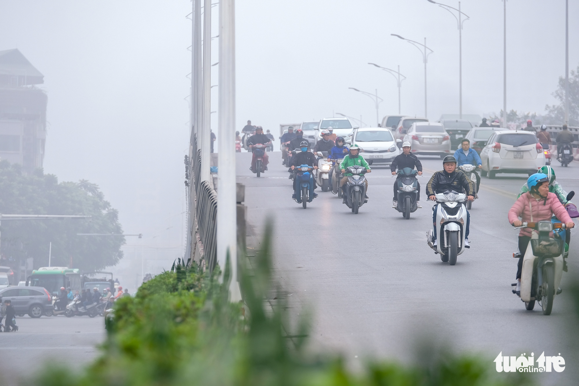 Commuters travel on Nguyen Chi Thanh overpass in Hanoi on the morning of December 24, 2019.