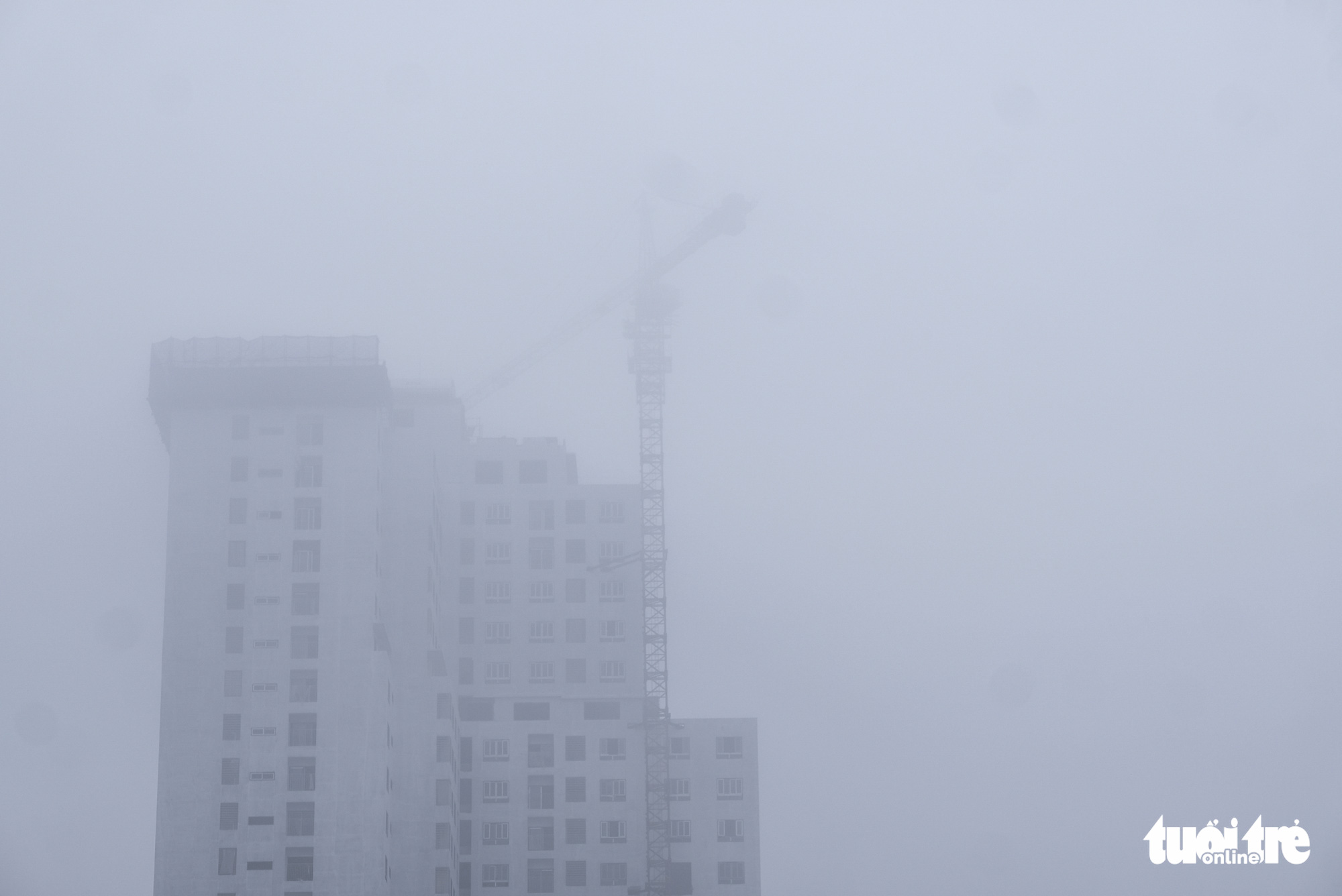A high-rise is barely visible due to foggy weather in Hanoi on December 24, 2019.