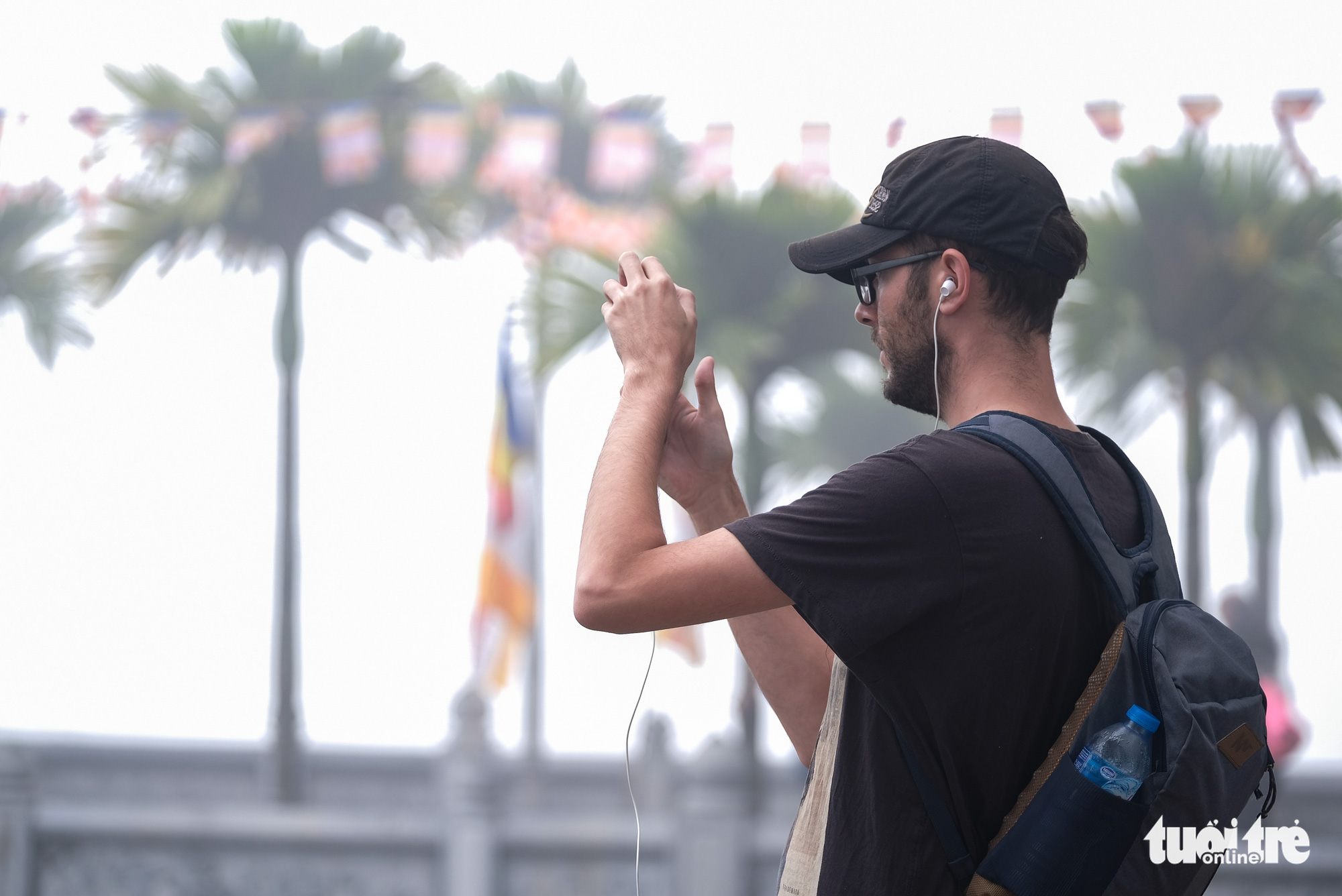 A foreigner takes a photograph of West Lake in Hanoi on December 24, 2019.
