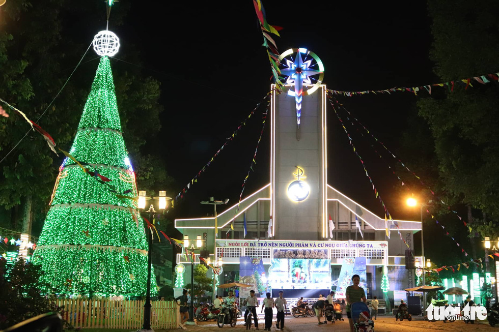 A giant Christmas tree made out of Christmas lights illuminates Tam Ha Church in Thu Duc District, Ho Chi Minh City. Photo: Khanh Tran / Tuoi tre
