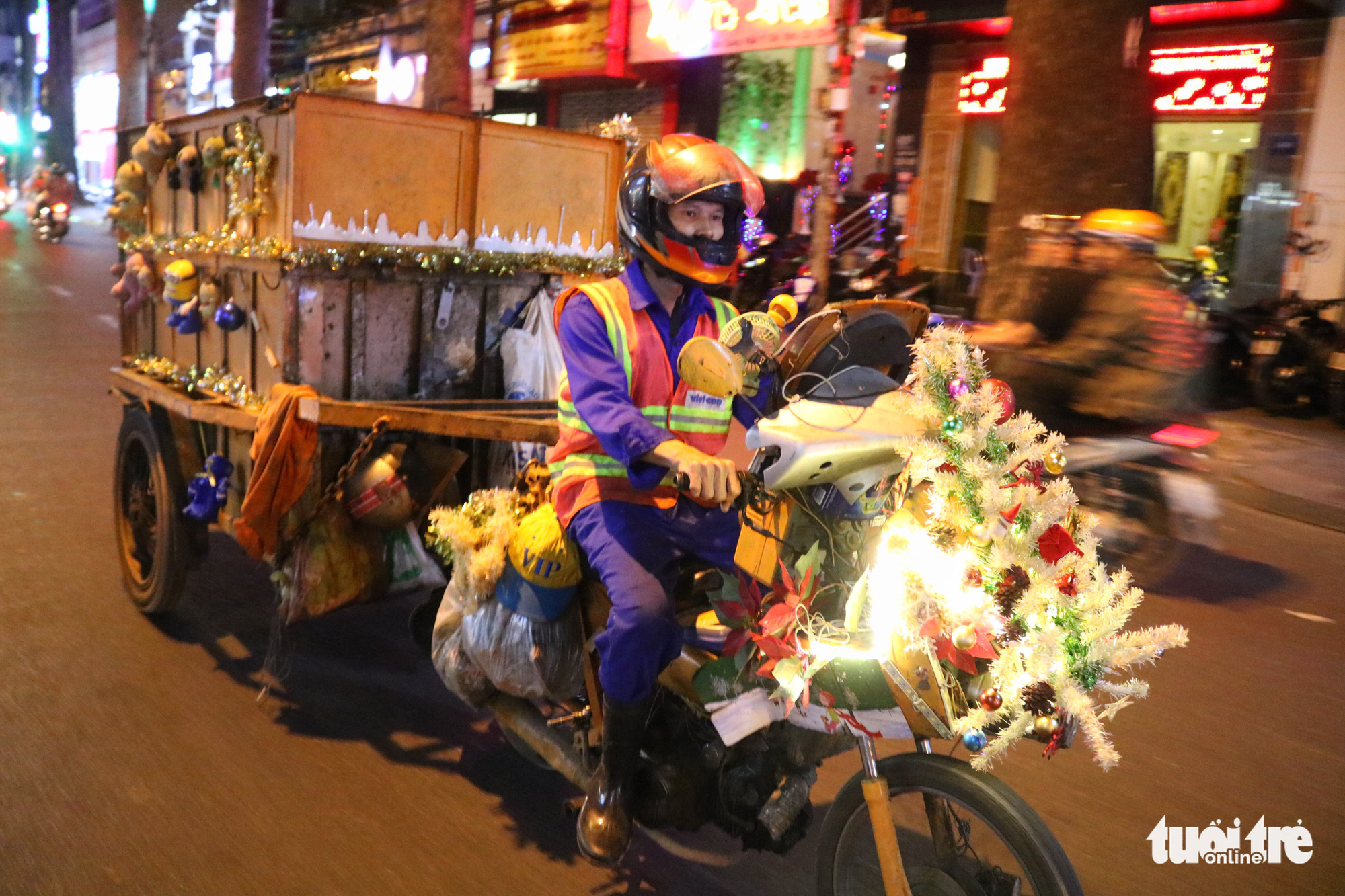 A street sweeper decorates his vehicle with Christmas adornments to celebrate the holiday while working on his shift in downtown Ho Chi Minh City on December 24, 2019.