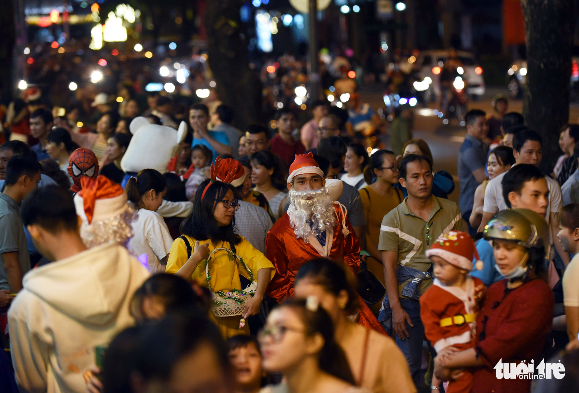 A young man dresses up as Santa Claus in front of a shopping mall in District 1, Ho Chi Minh City on December 24, 2019.